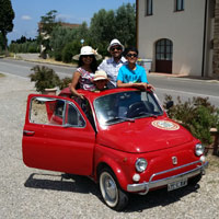 Family portrait on a vintage fiat 500 in Florence thumbnail